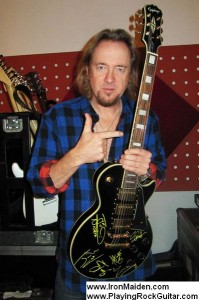 PlayingRockGuitar_Adrian_Smith_auction